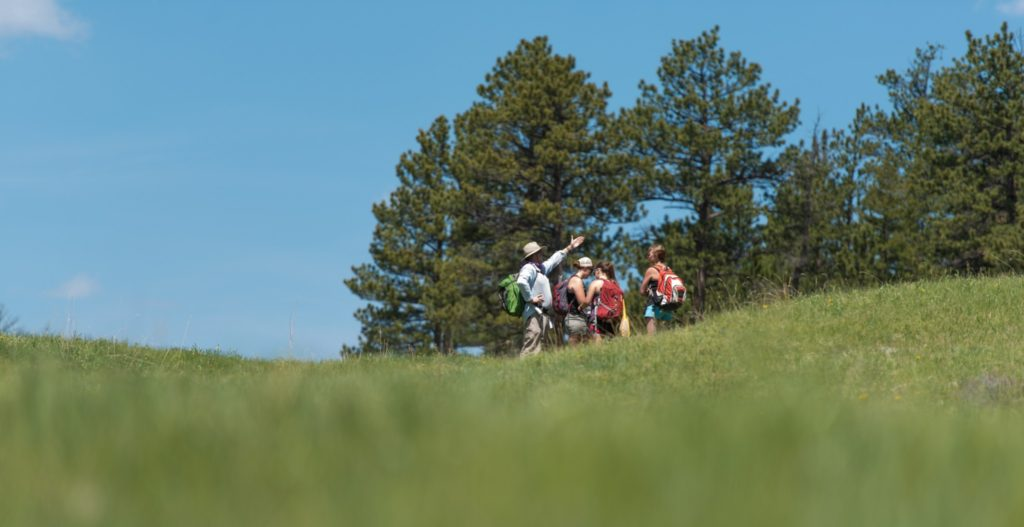 Photo of Professor Rocky Coleman instructing students outdoors at the CSU Mountain Campus