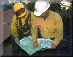 Wildland firefighters working with a map