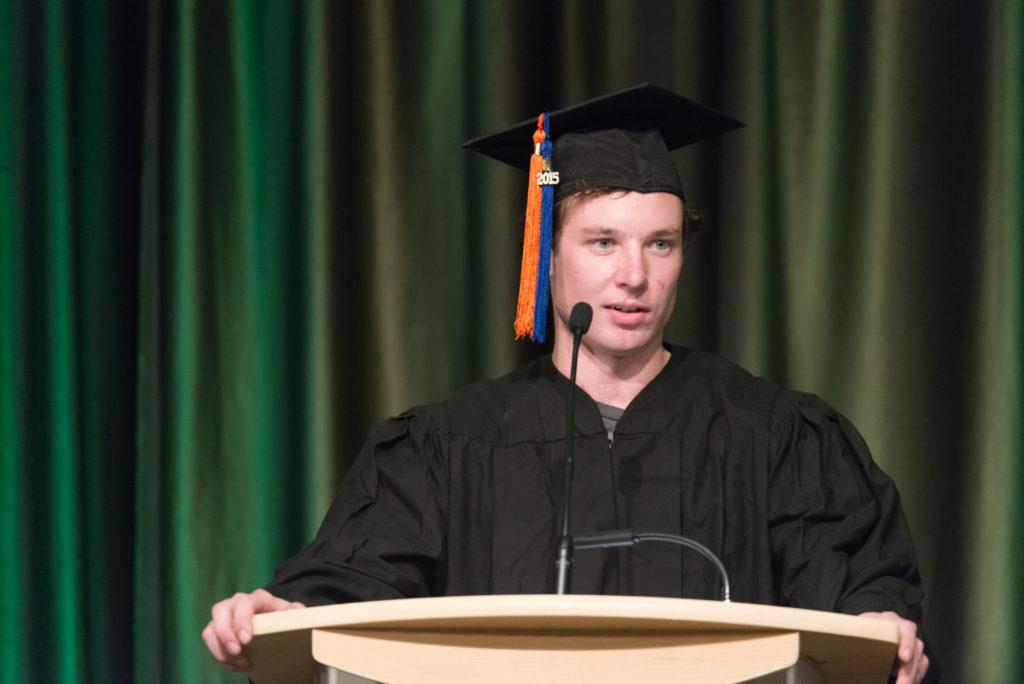 Kyle Gruenhagen standing behind a podium