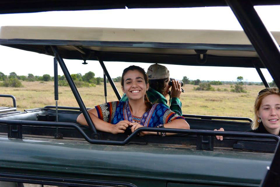 woman smiling in a tour jeep in Africa