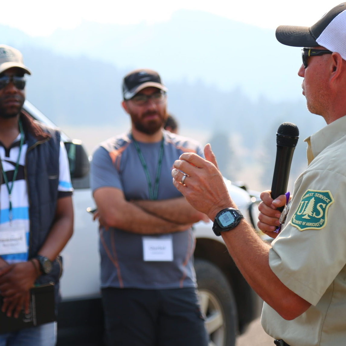 a ranger speaking to a group of people