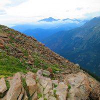 rocky hill beside a mountain