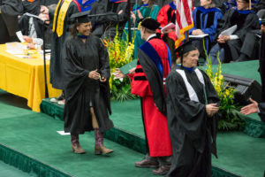 Woman shakes hands with the dean