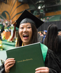 Warner graduate excitedly showing her diploma