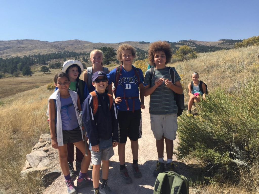 A group of kids pause while hiking
