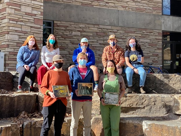 Eight ELC student employees pose outdoors