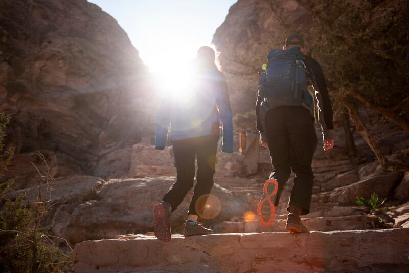 image of hikers with sun behind them